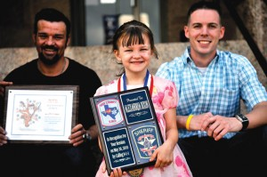 ALL SMILES - From left, Brent Dixon, Alley Dixon and communications officer Derek Pellizzari celebrate Alley's designation as a 911 hero outside the Wise County Courthouse Monday. Messenger photos by Joe Duty