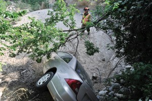 DOWN AND OUT - Jaqueline Smith and her stepdaughter Bridget Smith escaped with only a few scratches after their car was struck and fell down an embankment at the intersection Farm Road 730 and the U.S. 81/287 service road. Messenger photo by Joe Duty