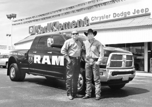 CHAMPS AND THEIR DIESELS - For a seventh time, Trevor Brazile (above, right) of Decatur has earned driving rights to a Dodge diesel by winning the Professional Rodeo Cowboy Association's All-Around World Championship. Handing over his newest Ram is Robert Bishop, general manager of Klement Chrysler-Dodge-Jeep-Ram in Decatur. Messenger photo by Ken Roselle