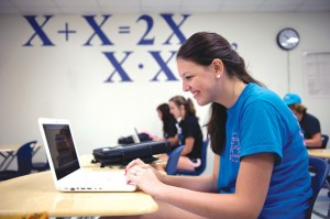 DIGITAL LEARNING - Junior Meagan Wynn, above, was among the first group of Decatur High School students to receive their laptops Wednesday. Wynn said she has never had a laptop before. Messenger photo by Joe Duty