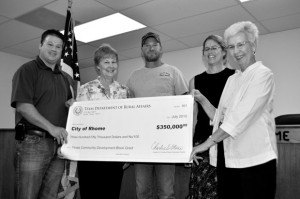 GRANT DESIGNS - The city of Rhome received a $350,000 grant check on Monday to replace an aging sewage treatment plant. From left is Kevin Smith, TDRA regional coordinator, city secretary Ramah Burns, public works director Preston Gilliam, municipal consultant Jessica Kaltenbach and mayor Evelyn Obenour.