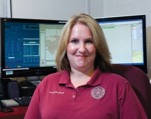 MORE THAN A JOB - Chief Randy Singleton said that for Cindy Skidmore, pictured above, being a dispatcher for the Bridgeport Police Department is a calling. Skidmore was named Telecommunicator of the Year for a national organization. Messenger photo by Joe Duty