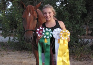 MULTIPLE WINS - Monika Qualls and her horse, Sunny, show off the ribbons they won at the State 4-H Horse Show. Submitted photo