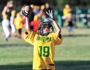 A BOY'S DREAM - Dalton Westray catches a pass during a recent football practice. The Boyd fourth grader, who was born Sept. 11, 2001, shines on the football field, as well as in the classroom. He has goals of playing football in college and studying medicine at the University of Texas.  Messenger photo by Joe Duty