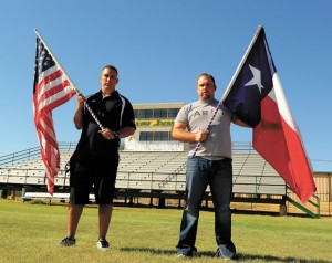 LINKS TO TRADITION - Brothers Dakota and Cisco Roberts display the flags the Boyd football team brings onto the field before each game. Cisco gave the flags, which flew in Iraq and Kuwait in 2003, to the football program. Messenger photo by Joe Duty