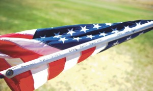 GRAND OLD FLAG - Boyd started the tradition of carrying the flag onto the field after September 11 and continue  it today. Messenger photo by Joe Duty