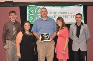 LEADER OF THE YEAR - John Moore, 4-H Leader of the Year, led the Food Challenge team to a win at State Roundup this summer. Team members include, (from left) Logan Moore, Bailey Morris, Sheryl Jennings and Christian Cross. Not pictured is Jodie Wells.