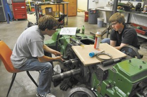 NATIONAL COMPETITION - Decatur High School seniors Colton Petty (left) and Cruz Niblett (right) will compete in the 84th annual National FFA Convention in Indianapolis this week. Petty will compete in tractor restoration, and Niblett will participate in the proficiency competition. After national competition, the duo will compete at stock shows in San Antonio, San Angelo and Houston with the pictured John Deere 830 diesel tractor. 2011 DHS graduate Cody Pollard also qualified for Nationals but will be unable to attend due to his college schedule. Messenger photo by Erika Pedroza