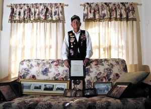 MEMORIES - World War II veteran B.J. Shepherd poses at his house in southwest Wise County with a collection of family photos and keepsakes, including a letter of gratitude sent to him after the war by Secretary of the Navy James Forrestal. Messenger photo by Joe Duty