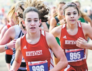 WORKING TOGETHER - Northwest's Kellee McCann and Katherine Chavez finished 16th and 17th in the Class 5A race Saturday in Round Rock. Messenger photo by Joe Duty
