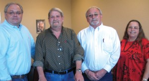 NEW BUSINESS IN TOWN - The Bridgeport Chamber of Commerce held a ribbon cutting ceremony Jan. 5 for 4-Star Loans. On hand for the celebration were (from left) Alan Byrd, Bill Parker, Jim Seals and Cindy White.