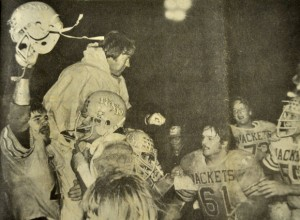 DISTRICT CHAMPIONS - Cartwright is hoisted up by players after winning the district title 7-0 against Windthorst in 1980. It was the 'Jackets first time in 10 years to win district. Messenger file photo by Ken Roselle