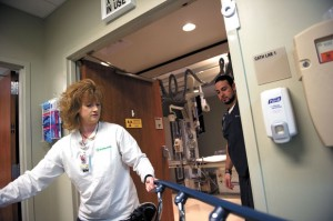 CATH LAB - Lacretia Miles, a nurse in the cardiac catheterization lab at Wise Regional Health System, pulls a gurney carrying a patient into the cath lab at the Decatur hospital as cardiovascular technologist Damien Morales CVT awaits their arrival. Messenger photo by Joe Duty