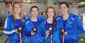 GOLDEN MOMENT - Decatur's 400 freestyle relay team of Audry McCreary, Haley Dennard, Kate Grant and Katey Rowden captured the gold medal Saturday. Messenger photo by Richard Greene