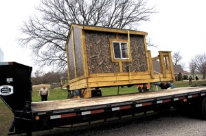 STRUCTURE SEIZED - A child's playhouse is loaded onto a trailer at the residence of Precinct 4 Commissioner Terry Ross Tuesday afternoon. It was seized after a search warrant was issued about 2:30 p.m. Messenger photo by Joe Duty