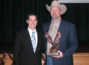 MARKETING AND ADVERTISING - Jeff Jones, representing David's Western Store and National Roper's Supply, receives the award for marketing and advertising strategies from EDC Director Jody Adams.