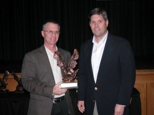 QUALITY PRODUCTS - Jim Darnell of Landmark Fabrication receives the award for quality products from EDC President Andrew Sandford.