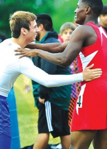 SIGN OF SPORTSMANSHIP - Mineral Wells' Adrian Colbert congratulates Decatur's Jake Anderson after the 400 Thursday at the District 7-3A meet. Messenger photo by Joe Duty