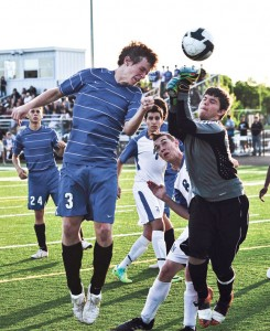 USING HIS HEAD - Decatur's Harry Boatman heads the ball out of harm's way during the Eagles' 2-0 playoff loss to Byron Nelson Wednesday. Messenger photo by Joe Duty