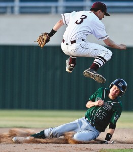 CLOSE CALL - Bridgeport shortstop Alex Samples jumps over Kennedale's Jordan Braswell as he slides into second base during the Wildcats' 12-3 victory over the Bulls Thursday. Messenger photo by Joe Duty