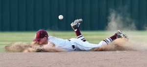 COMING UP SHORT - Bridgeport's Dalton Hudson dives for a ball during the Bulls' 12-3 loss to Kennedale Thursday. Messenger photo by Joe Duty