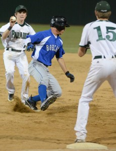 ESCAPING TRAP - Krum's Brandon Ellis tries to avoid tag of Paradise's Jarrett Holt. Ellis eventually stole second on the play in Krum's 11-1 win. Messenger photo by Mack Thweatt