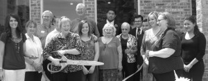 OPEN INN - The Bridgeport Chamber of Commerce held a ribbon cutting for Bridgeport Lake Bed and Breakfast April 26. Pictured is Regina Partain, innkeeper.