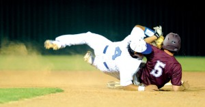 TAKING A TUMBLE - Decatur's Christian Carrillo falls on Bridgeport's Dillon Waldrep as he slides into second base during the Bulls' 8-4 win over Decatur Friday. Messenger photo by Joe Duty