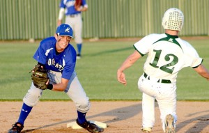 THROWN FOR A LOSS - Krum shortstop Caz Wojiak tags out Paradise's Logan Bailey during the Panthers'  11-1 loss. Messenger photo by Mack Thweatt