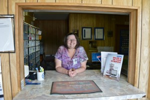 WE'RE STILL HERE - On Wednesday, Slidell Postmaster Brenda Miller found out that the U.S. Postal Service will not close the thousands of rural offices, including Slidell and Greenwood, it had planned to in the fall. Messenger photo by Joe Duty