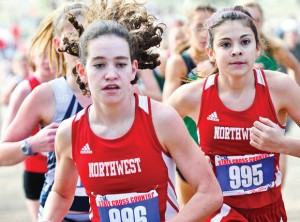 NEW CHALLENGE - Northwest's Kellee McCann and Katherine Chavez made the state cross country meet last year. They will try to make it back this year to run the new 5K for Class 5A and 4A girls. Messenger photo by Joe Duty