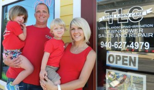 NEW LOCATION - Scout, Chris, Kai, Micah (and coming soon Baby Kit) Fernihough celebrate the new location of their business, TLC Lawnmower Sales and Repair, at 105 E. Main St. in Decatur. Messenger photo by Kelly Guess