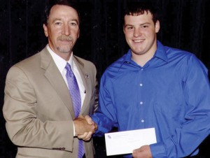 SCHOLARSHIP RECIPIENT - SFA student Hollis Gregory receives the Forestry Scholarship from the Pineywoods Chapter of Safari Club International from Dr. Steven Bullard, dean of the Arthur Temple College of Forestry and Agriculture, at the 2012 Forestry and Environmental Science Awards Convocation. Submitted photo