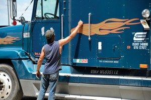 7:30 A.M. - Bud Beavers wakes a truck driver from his slumber to work on his truck. Messenger photo by Joe Duty