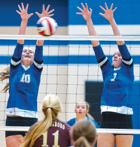 BACK AT YOU - Decatur's Cooper Martin and Darci Billmire go up for the block Tuesday against Whitesboro. Messenger photo by Joe Duty
