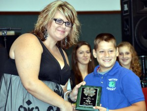 BRONZE AWARD - Clint Demmitt of Chico 4-H receives the Bronze Award from 4-H Program Assistant Andrea Calabretta. Ray Edwards of Paradise 4-H was also awarded the Bronze Award, but he was not present.