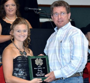 FRIEND OF 4-H - Mike Porter accepts the Friend of 4-H Award from Morgan Barnes on behalf of AGvantage Farm and Ranch in Decatur.