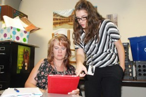 GETTING CONNECTED - Seven Hills Elementary School teacher Lyndsie Graves (right) shows Kirsten Wilson, Haslet Elementary teacher (left), new applications to use on her iPad to formally assess student learning. Submitted photo