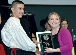 HARD WORK REWARDED - Christian Cross of Boyd 4-H receives the Danforth I Dare You Award from 4-H Agent Chrissy Karrer.
