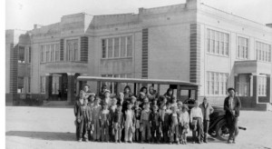 HISTORIC SAMPLE - A group of students stand in front of a bus at Decatur Public School in the 1930s. This is an example of the type of photos sought for the project at Weatherford College Wise County. Courtesy of the Wise County Historical Society