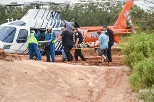 Tommy Hahn, 26, of Decatur  is carted from the track to a waiting medical helicopter. Photo by Joe Duty
