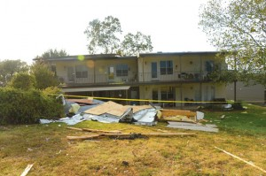 STRUCK AGAIN - Microburst winds pried the roof off of an eight-unit condominium on Runaway Bay Drive in Runaway Bay Drive. Although four families were displaced, no one was injured. Messenger photo by Joe Duty