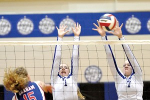 ANOTHER SWEEP - Decatur&#039;s Stormi Leonard and Darci Billmire go up for a block during the Lady Eagles win over Graham Tuesday. Messenger photo by Clay Corbett