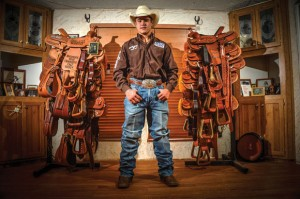 BIG WINNING - Brett Stuart of Bridgeport has won numerous saddles having rodeoed since he was 3, but perhaps the most coveted is the one he earned for winning the National High School Rodeo Association Junior Division title in team roping in July. Messenger photo by Joe Duty