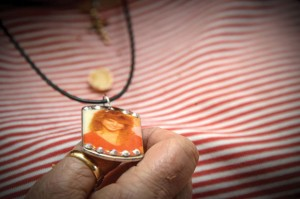 CLINGING TO HOPE - Wise County resident Sharon Harvey wears a pendant with the photo of her late daughter, Ginger Hayden. Messenger photo by Joe Duty