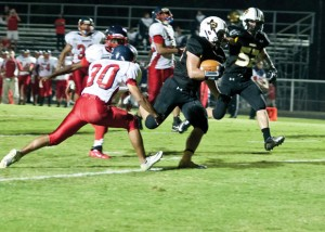 CROSSING THE LINE - Chico&#039;s Dylan Hightower carries into the end zone for a Dragon touchdown against Dallas Academy. Chico put 64 points on the board in the first half. Messenger photo by Jimmy Alford