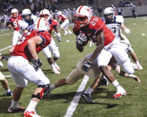 GO AROUND - Northwest&#039;s Emmanual Moore breaks a tackle against Keller. Messenger photo by Joe Duty
