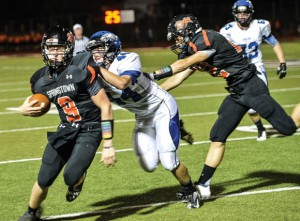 GOING DOWN - Decatur's Ethan Currin pulls down Springtown quarterback Colby moore. Messenger photo by Joe Duty