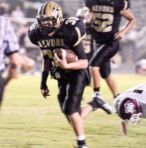 HEADING DOWNFIELD - Bulldog running back Joe Randall breaks free during one of his 13 runs in Friday night's victory over Millsap. Messenger photo by Mack Thweatt