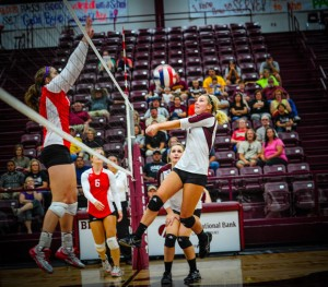 MID-AIR - Bridgeport's Tiffany Hawkins get the ball back over the net in the Sissies game with Mineral Wells Tuesday. Messenger photo by Joe Duty